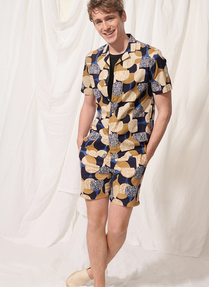 """All smiles, Tom Webb wears a Club Monaco notched collar moon print shirt $89.50 and 7"""" shorts $89.50."""