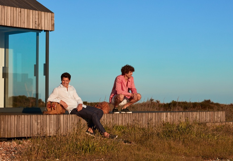 Models William Goodge and Max Rogers don summer fashions by Derek Rose.