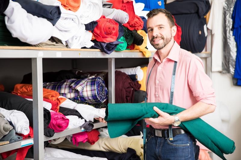 Designer Choosing Fabric Male