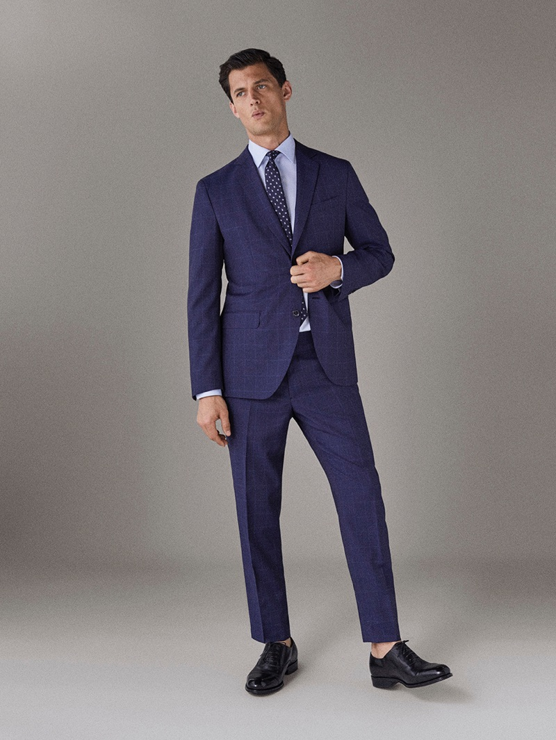Garrett Neff dons a blue suit by Massimo Dutti.