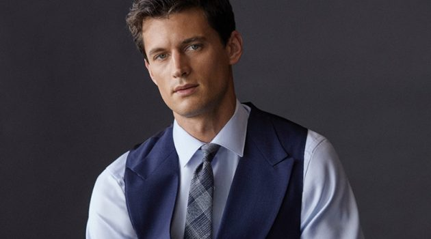 Front and center, Garrett Neff models a shirt, waistcoat, and tie by Massimo Dutti.