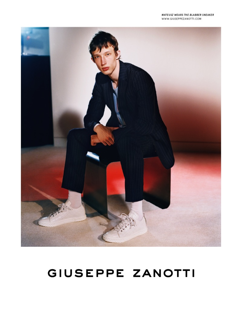 Mateusz Chmielewski stars in Giuseppe Zanotti's fall-winter 2019 men's campaign.