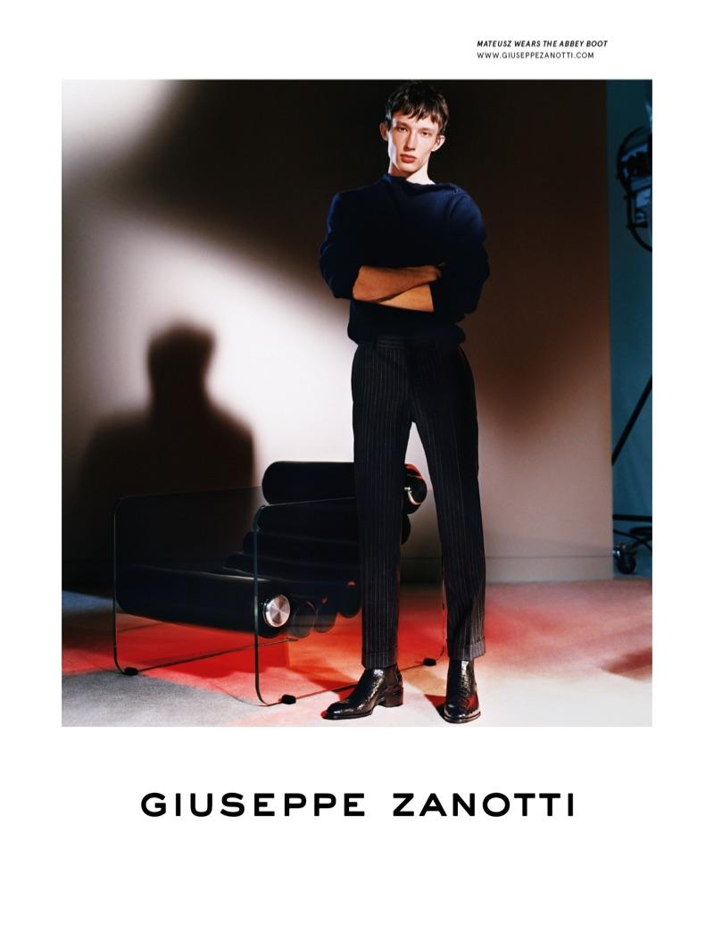 Model Mateusz Chmielewski fronts Giuseppe Zanotti's fall-winter 2019 men's campaign.