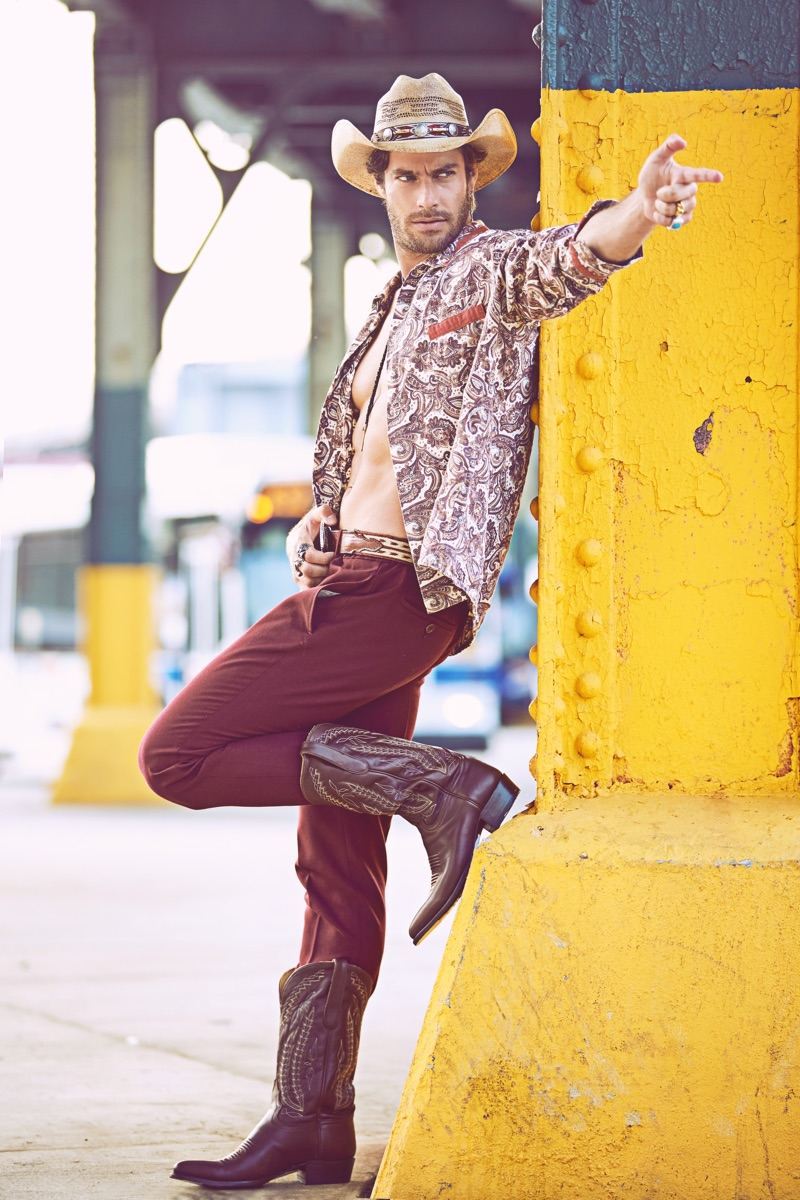 Gonçalo wears vintage shirt stylist's own, hat, boots, and belt Space Cowboy, pants Aspesi, and bolo tie Britt Bolton Jewelry.