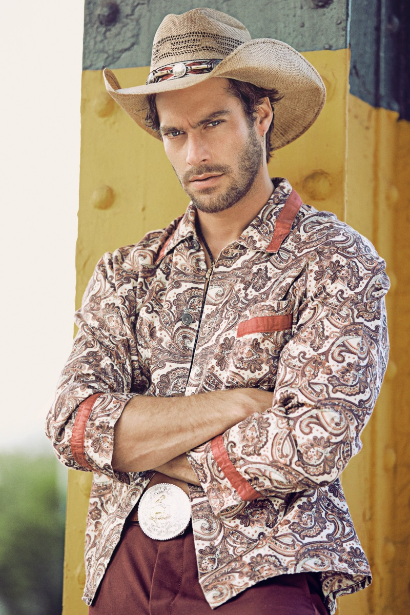 Gonçalo wears vintage shirt stylist's own, hat and belt Space Cowboy, pants Aspesi, and bolo tie Britt Bolton Jewelry.