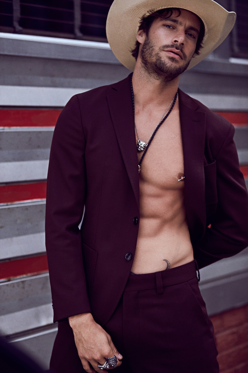 Gonçalo wears suit BOSS, hat Space Cowboy, bolo tie and necklace Britt Bolton Jewelry.