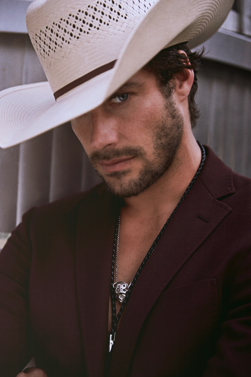 Gonçalo wears suit jacket BOSS, hat Space Cowboy, and bolo tie Britt Bolton Jewelry.