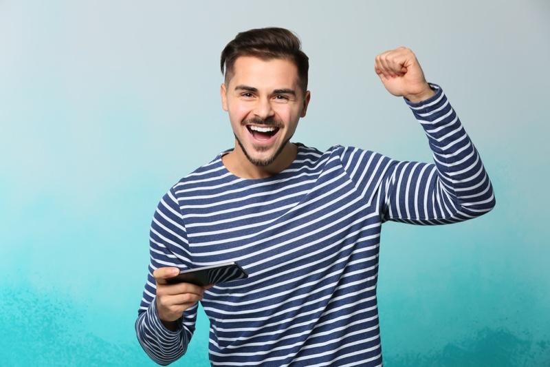 Guy Celebrating Mobile Game Striped Shirt