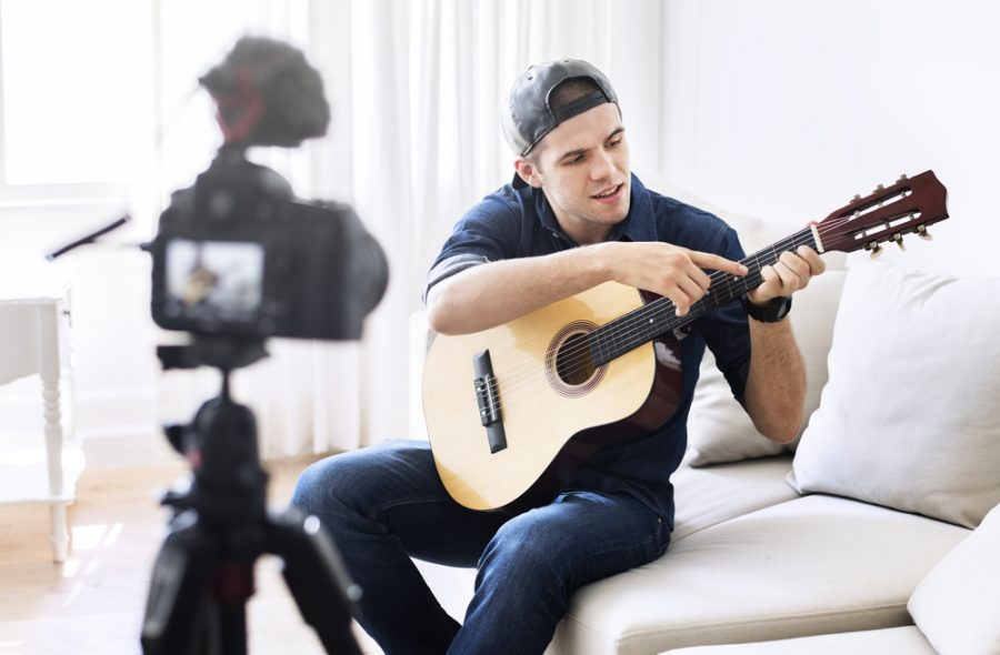 Influencer Youtuber Making Video with Guitar Guy