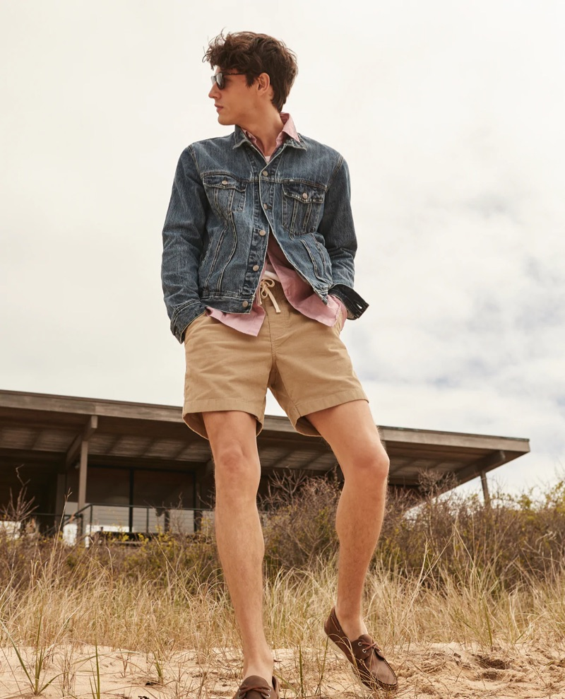 Modeling timeless classics, Nicolas Ripoll wears J.Crew's classic denim jacket $98, organic cotton shirt $59.50, dock shorts $54.50, and Wharf sunglasses $59.50. He also dons a Wallace & Barnes pocket tee $49.50 and Sperry for J.Crew boat shoes $98.