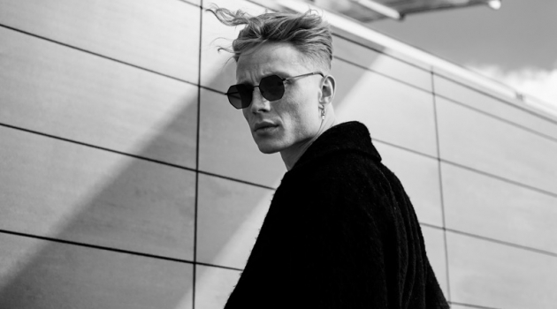 A cool vision, Jan Siegmund dons an oversized coat and sunglasses.