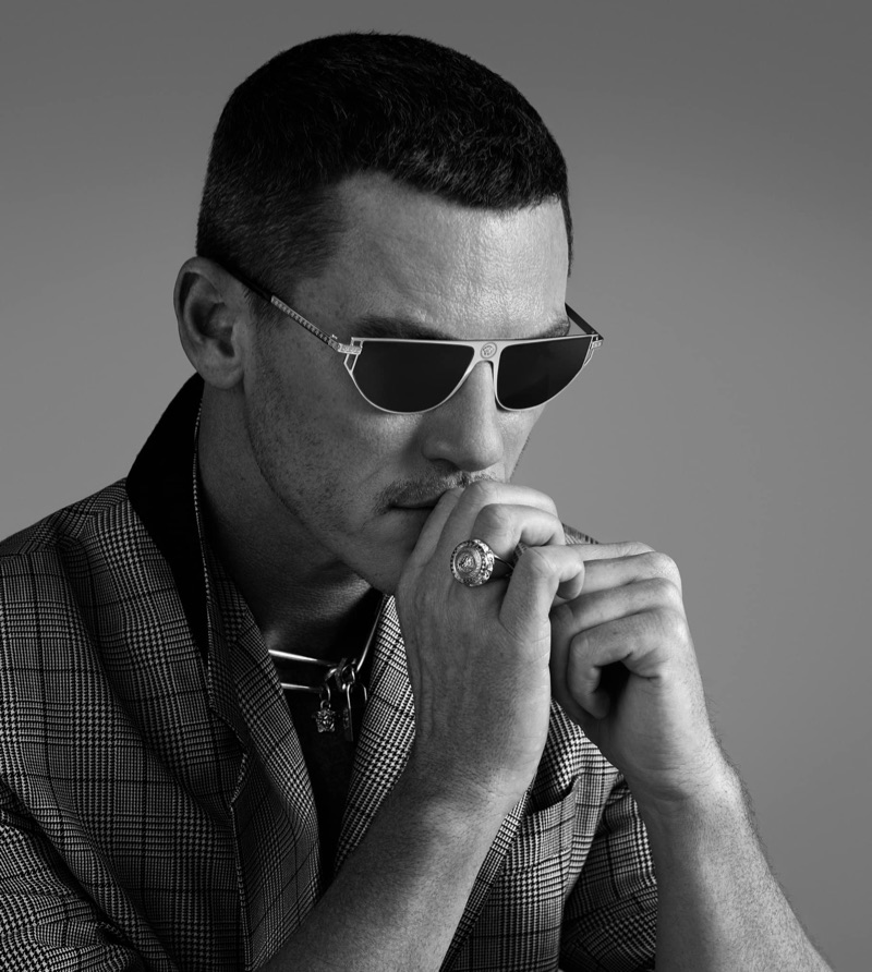 Appearing in a black and white photo, Luke Evans stars in Versace's Grecamania eyewear campaign.