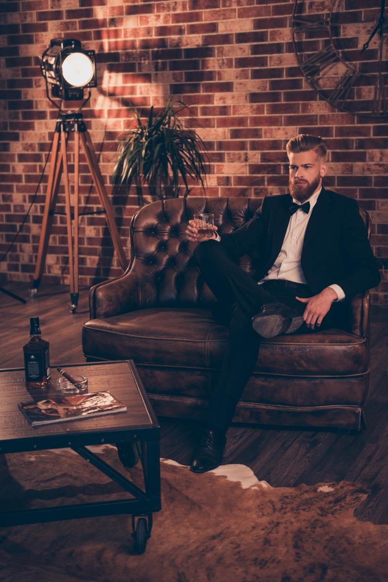 Male Model Sitting Posh Setting Tuxedo