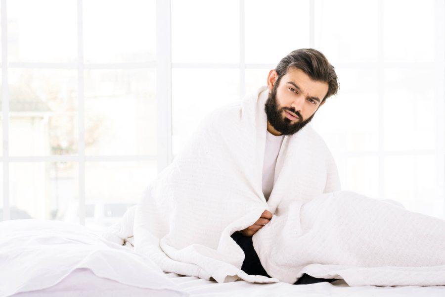 Man in Bed White Down Comforter Mattress