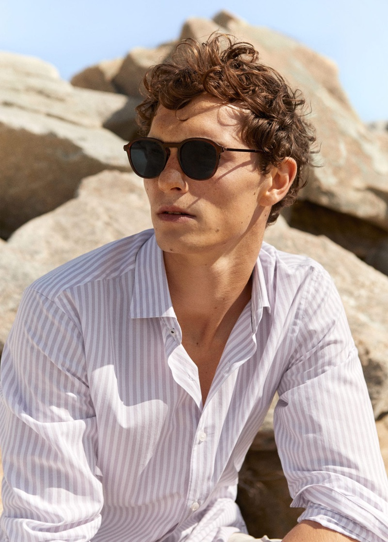 Model Luc Defont-Saviard sports a striped shirt from Mango.