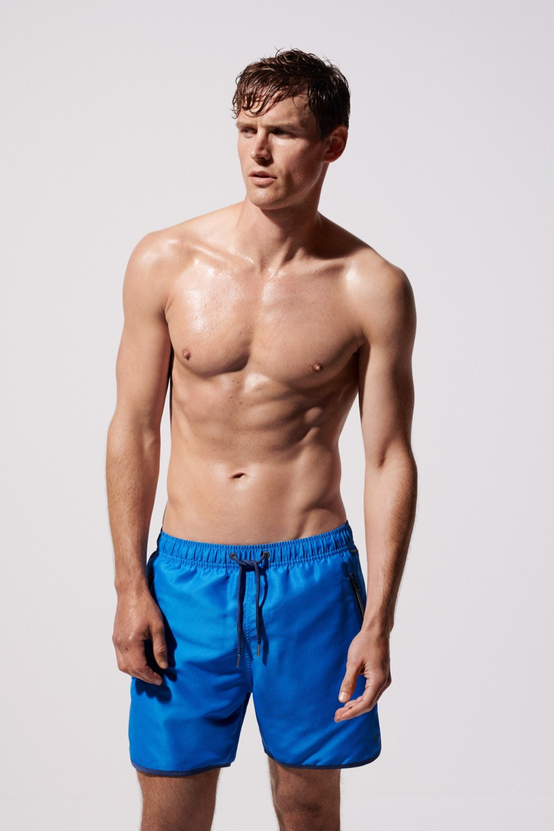 British model Guy Robinson wears swim shorts for the Marc O'Polo Body & Beach campaign.
