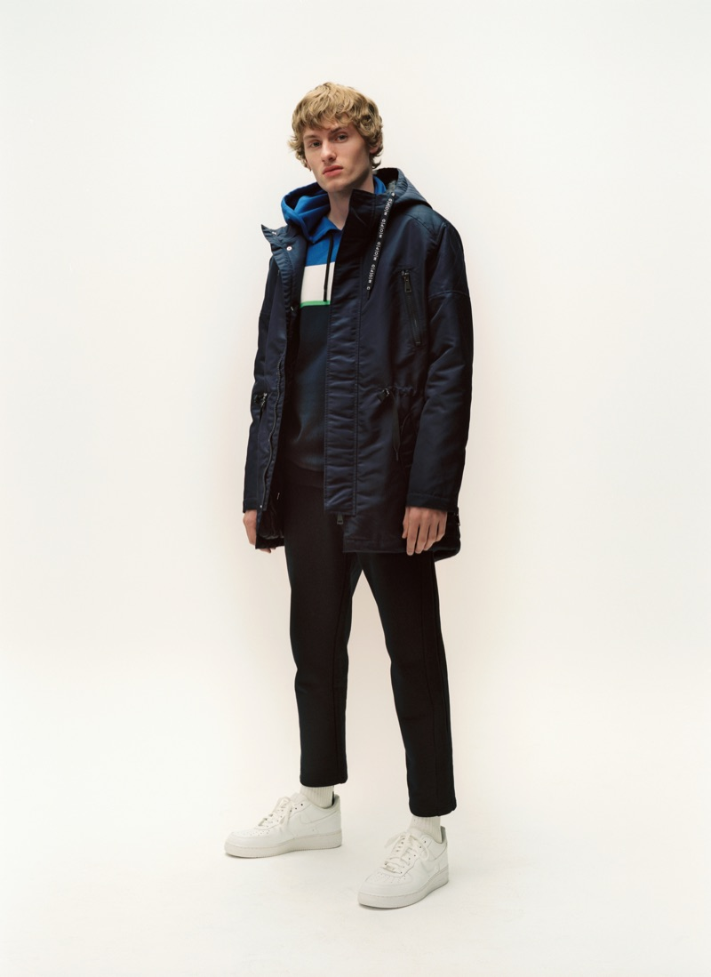 Front and center, Lemmie van den Berg dons a parka and denim from Marc O'Polo.