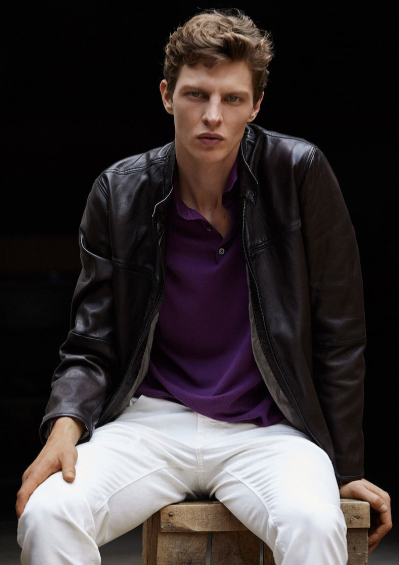 Embracing a splash of purple with a polo, Tim Schuhmacher sports a look by Massimo Dutti.