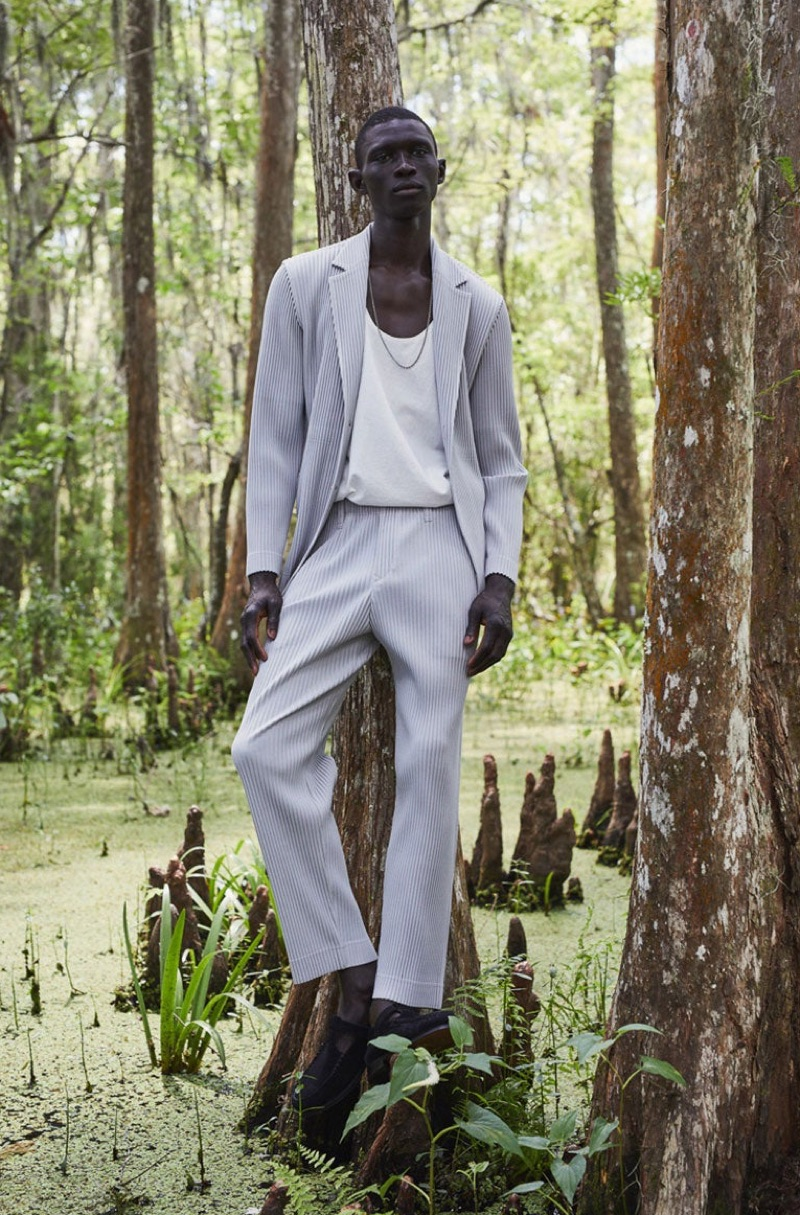 Fernando Cabral dons a suit by Homme Plissé Issey Miyake with a Bottega Veneta tank and Hereu shoes.