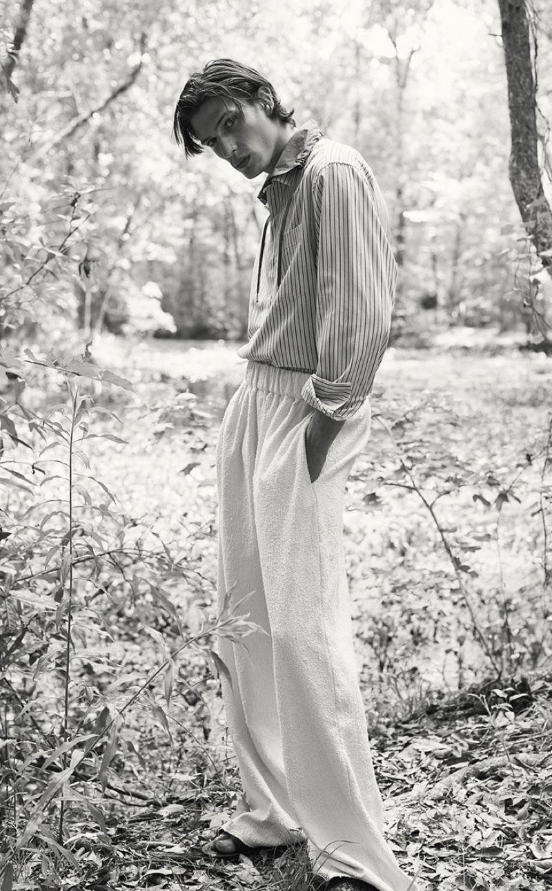 Donning neutrals, Edoardo Sebastianelli models a Lanvin shirt with Marrakshi Life trousers, and Bottega Veneta slides.