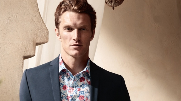 Shaun Dewet wears a floral print shirt with a smart blazer from OLYMP.