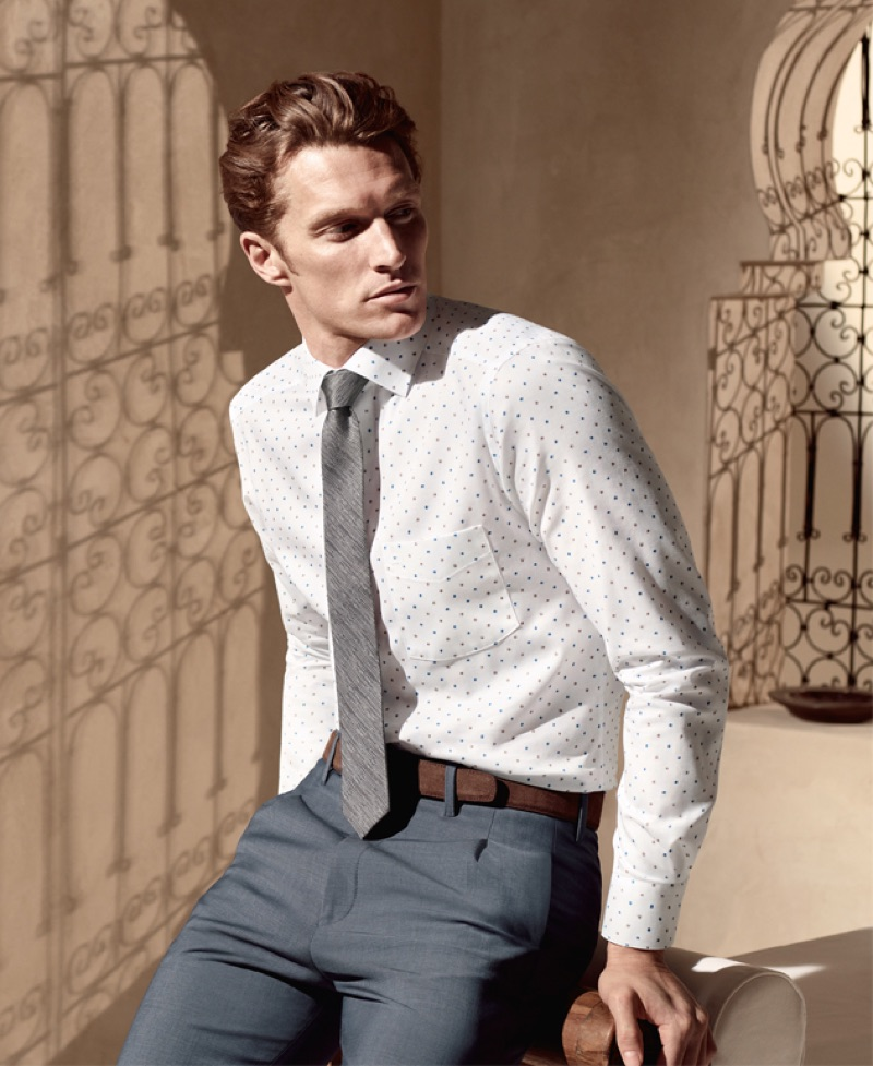 A smart vision, Shaun Dewet wears a shirt, tie, and trousers by OLYMP.