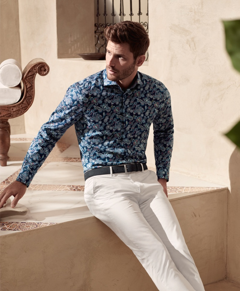 Samuel Trepanier is dashing in a paisley print shirt and light colored pants from OLYMP.
