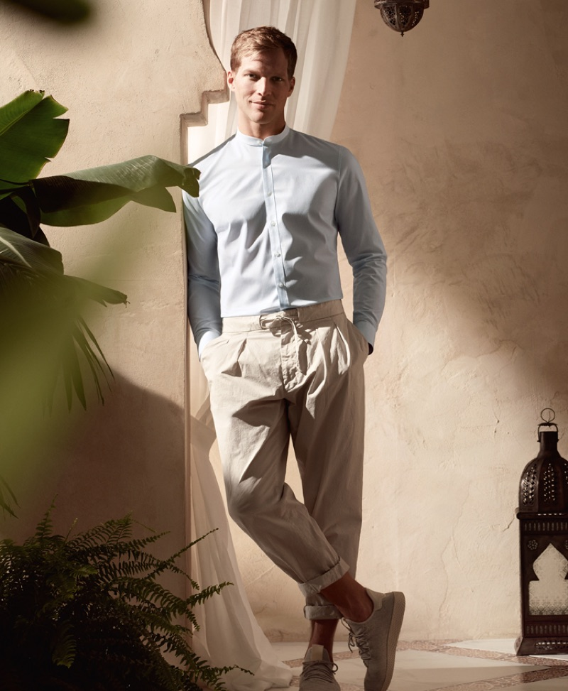 Geoffroy Jonckheere embraces summer style in an OLYMP grandad collar shirt and drawstring waist pants.