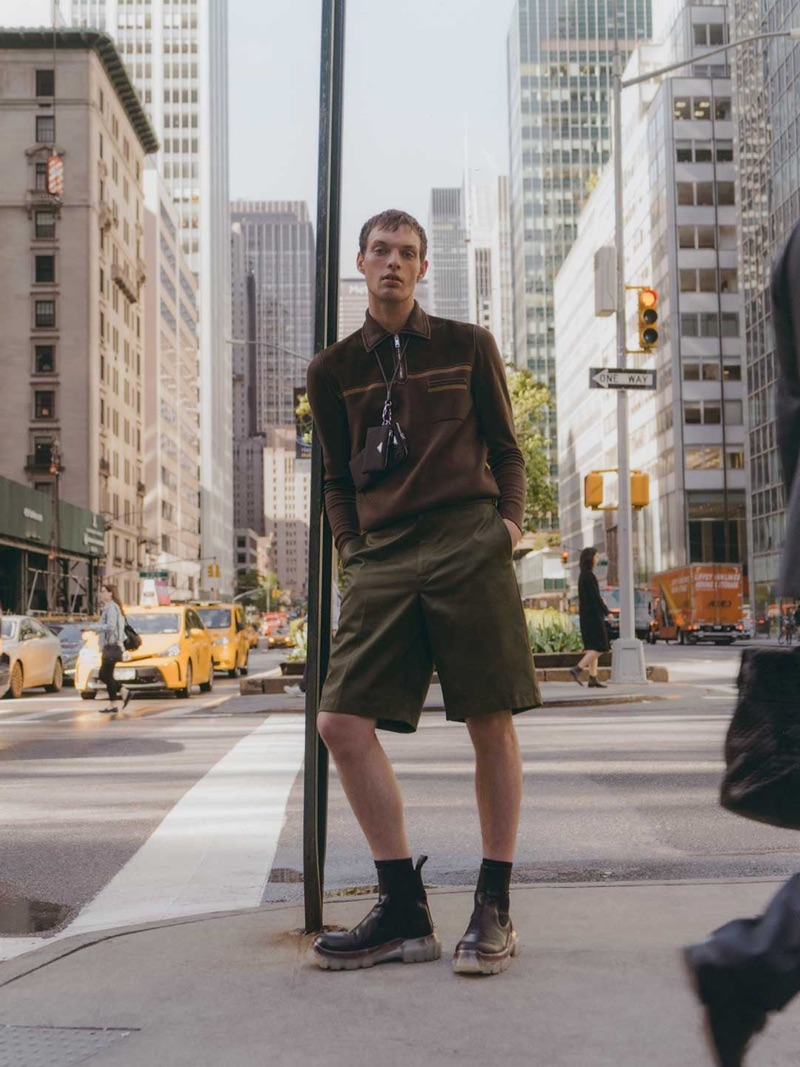 Stepping out, Rocky Harwood wears a Prada top, shorts, and lanyard with Rick Owens boots.