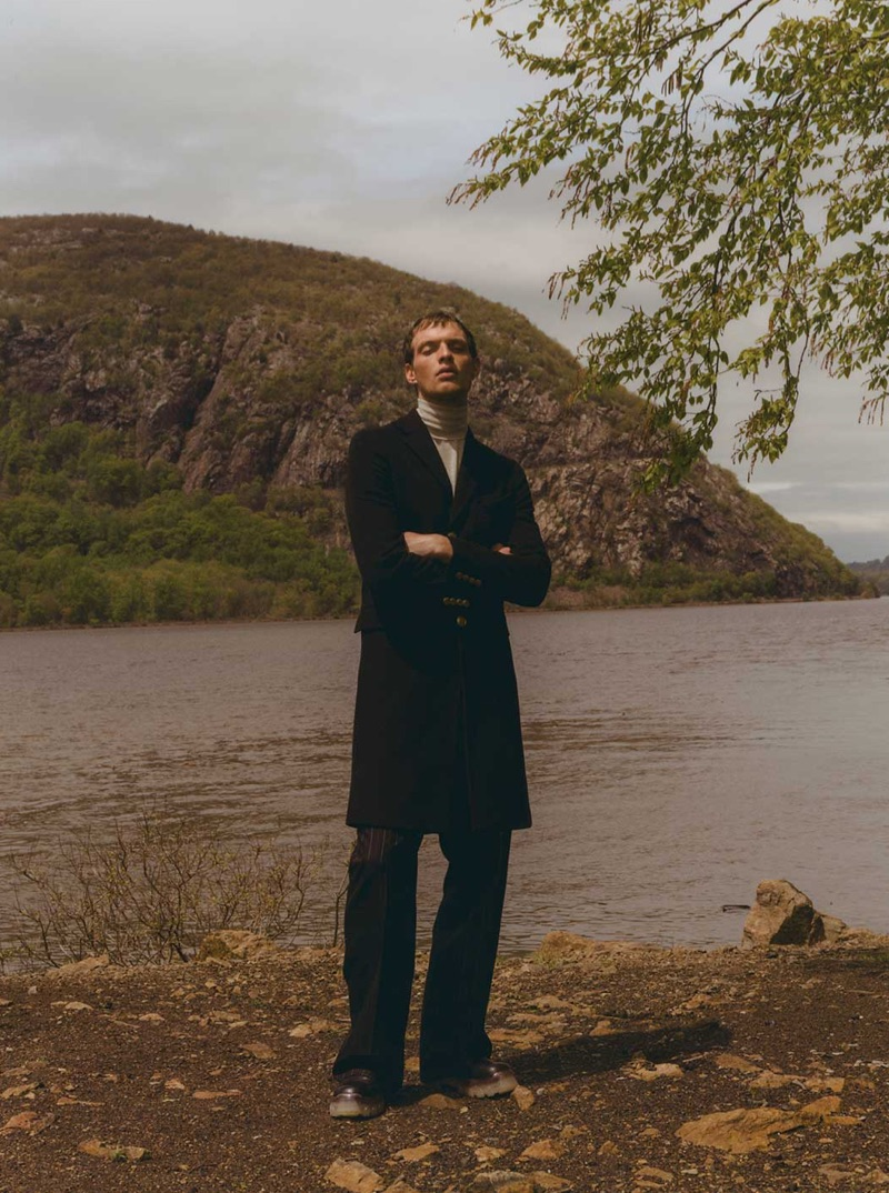 Taking to the outdoors, Rocky Harwood dons a Givenchy coat and Rick Owens boots with a sweater and trousers by Lanvin.