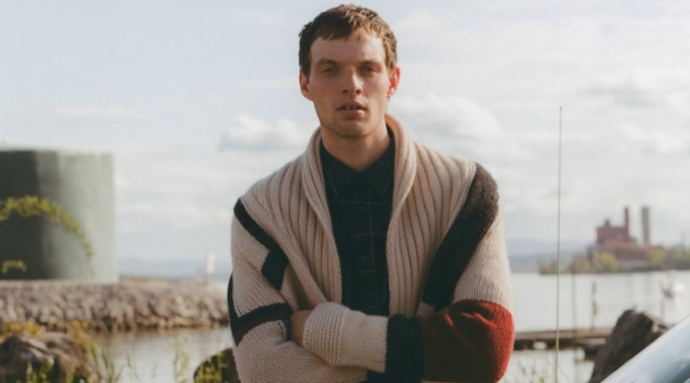 Ready for the new season, Rocky Harwood models a Connolly cardigan, A.P.C. shirt, and Helmut Lang shorts.