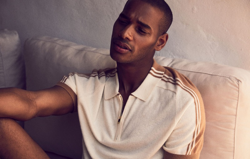 Stealing a relaxed moment, Sacha M'Baye wears Reiss.
