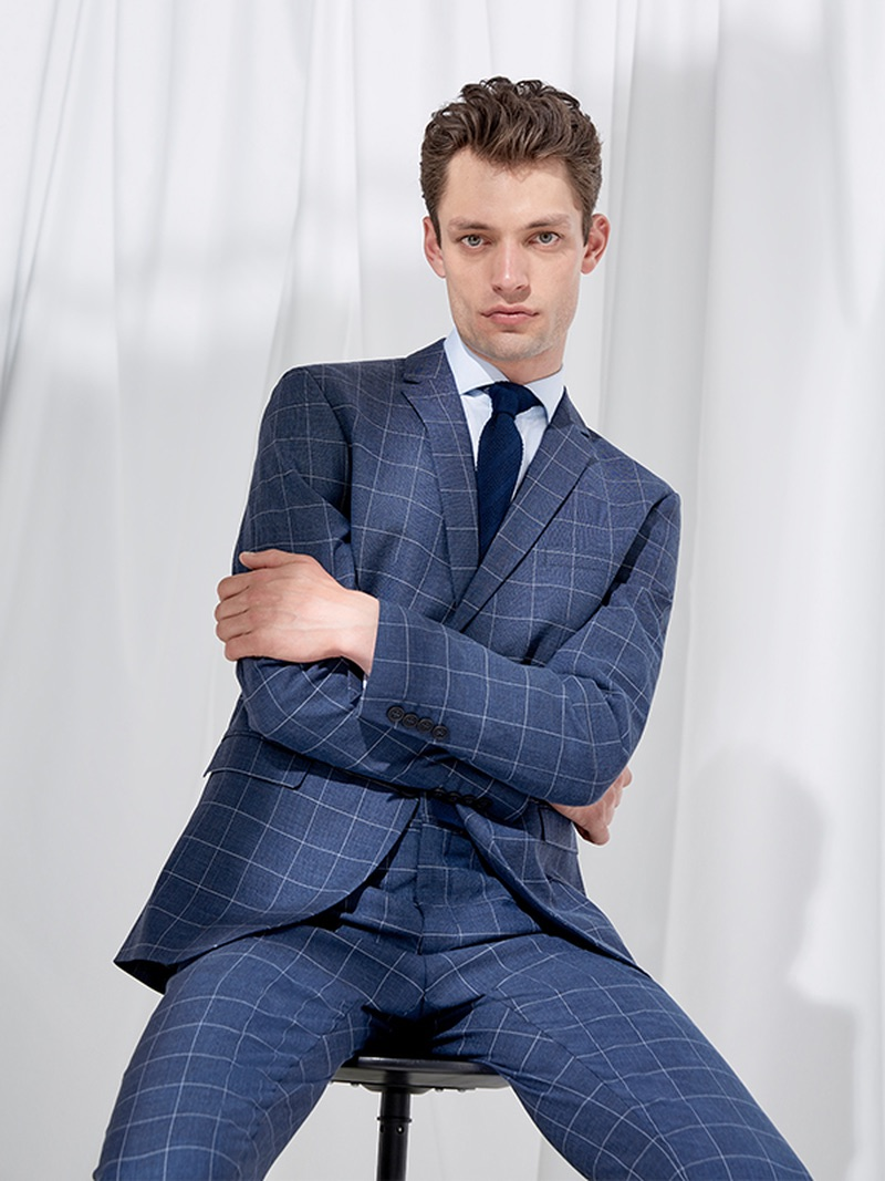 Nick Rea dons a windowpane print suit from Selected Homme.