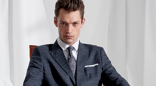 Model Nick Rae dons an elegant suit from Selected Homme.