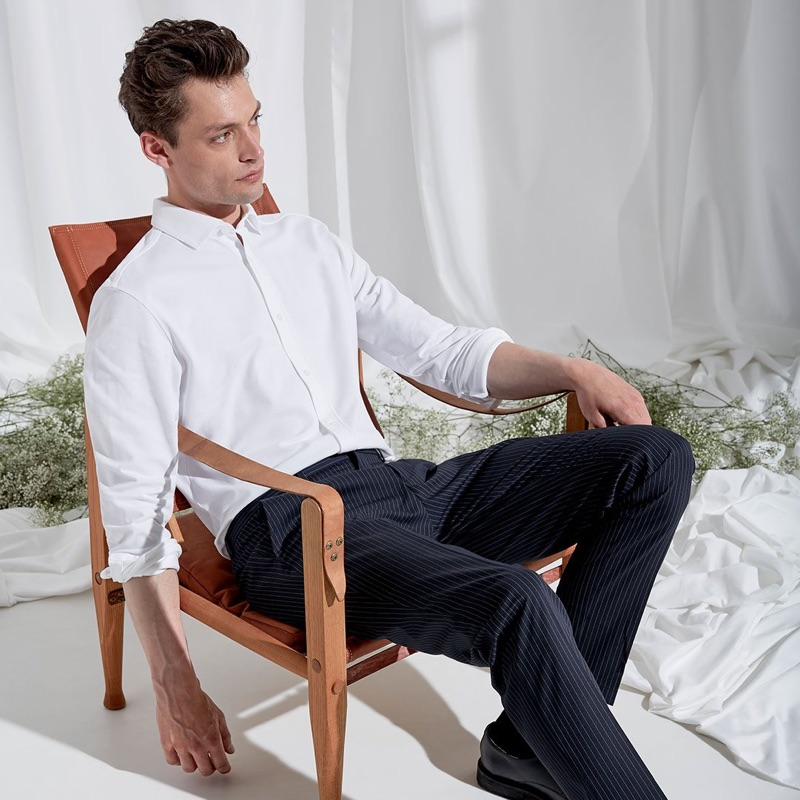 A smart vision, Nick Rea wears pinstripe trousers with a crisp white shirt.