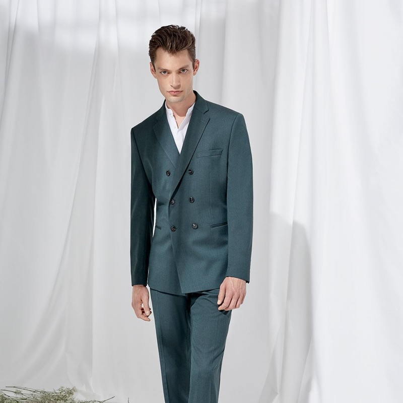 Donning a double-breasted suit, Nick Rea models Selected Homme.