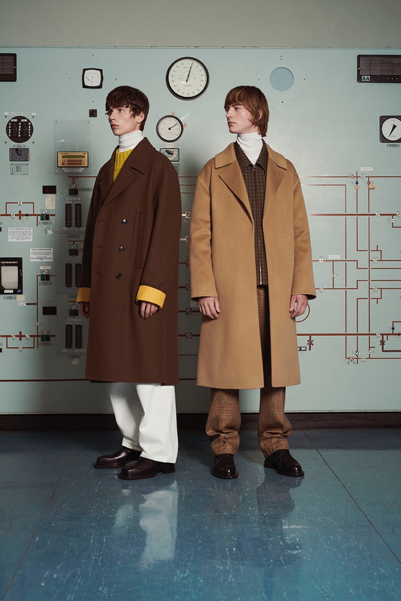 Donning oversized coats, Augusts Traumanis and Bartolomé Chapel wear looks from Solid Homme's fall-winter 2019 collection.