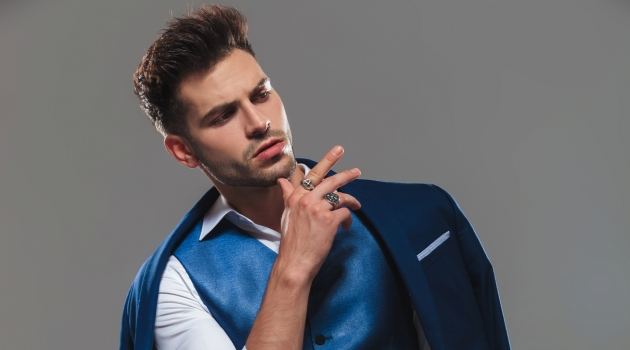 Stylish Man Posing Wearing Suit Vest and Rings