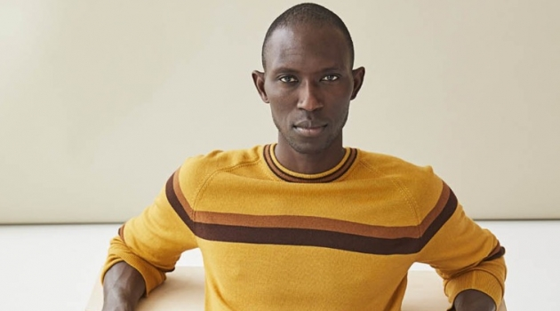 Armando Cabral sports a mustard yellow fine Italian merino wool stripe sweater $198 from Todd Snyder.