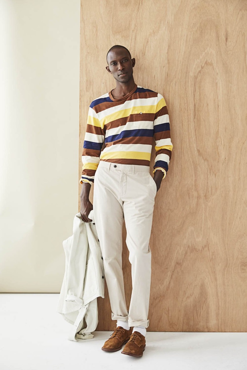 Making a colorful statement, Armando Cabral dons a bold long-sleeve striped tee $98.