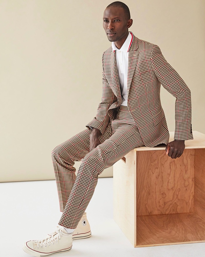 A sharp vision, Armando Cabral wears Todd Snyder's red and brown check Sutton suit.
