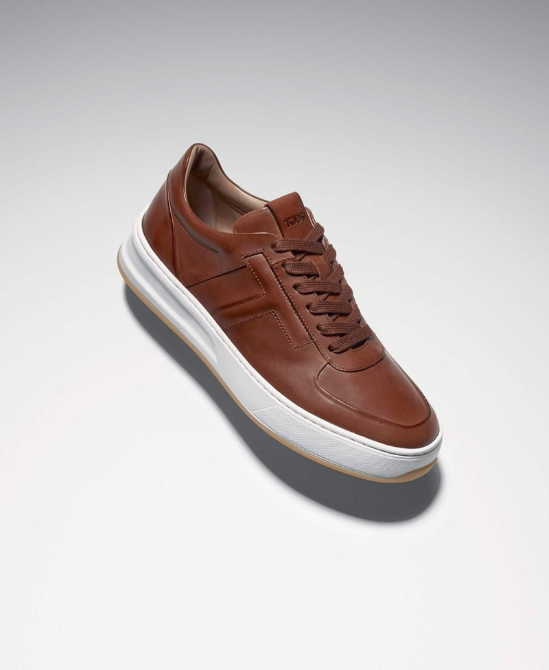 Tod's elevates sneakers with its brown leather style.