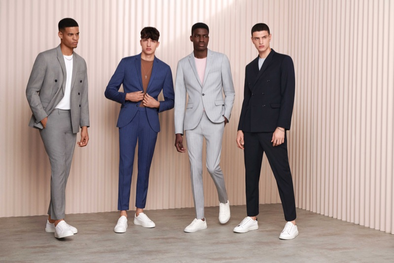Models Glen Abrantes, Romain Hamdous, Michael Oladayo Chima, and Azim Osmani don suits with white sneakers from Topman.