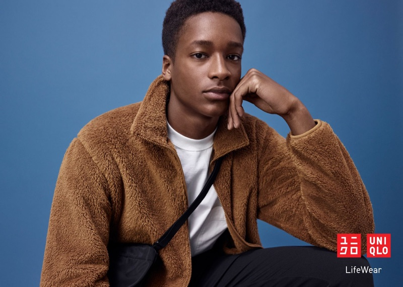 Jesajah Gemin dons a brown fleece jacket for the UNIQLO LifeWear fall-winter 2019 men's campaign.
