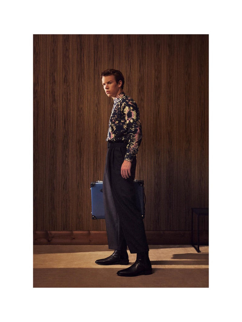 Showcasing designer fashions, Will Poulter wears a DRIES VAN NOTEN shirt £325 and trousers £475; GLOBE-TROTTER Deluxe trolley case £2,110; PIERRE HARDY boots £715.