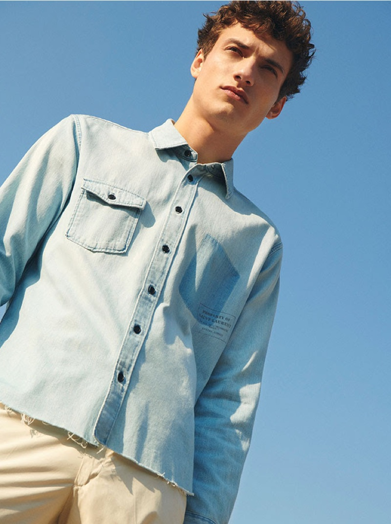 Donning denim, Serge Rigvava wears a look for YOOX.