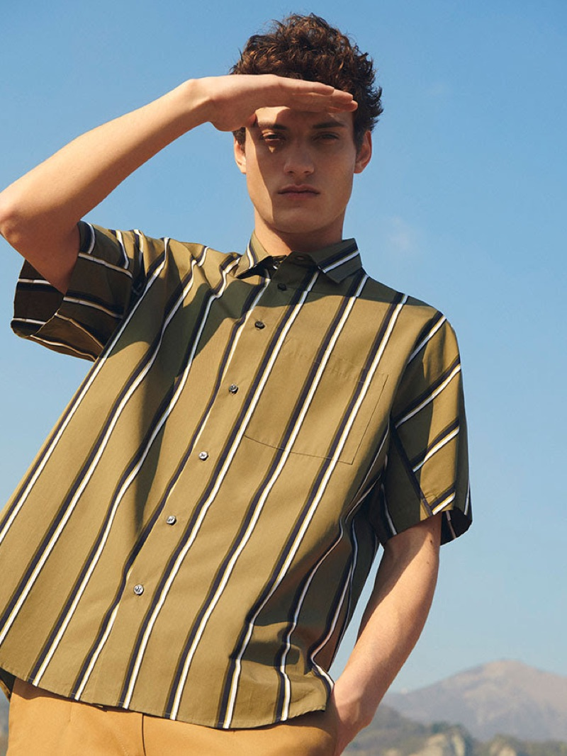 Serge Rigvava sports a striped short-sleeve shirt by OAMC.