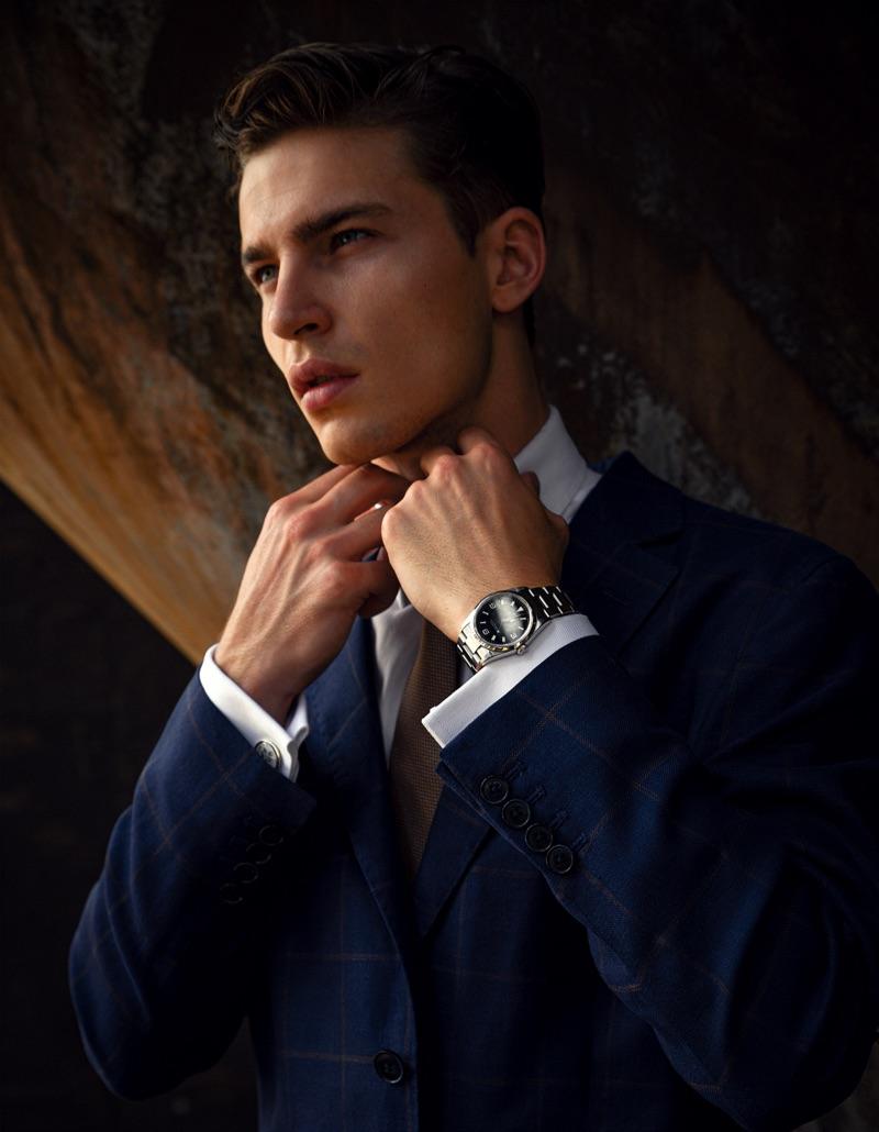 Yulef wears tie BOSS, watch Rolex Oyster Perpetual, and blazer and Hackett London.