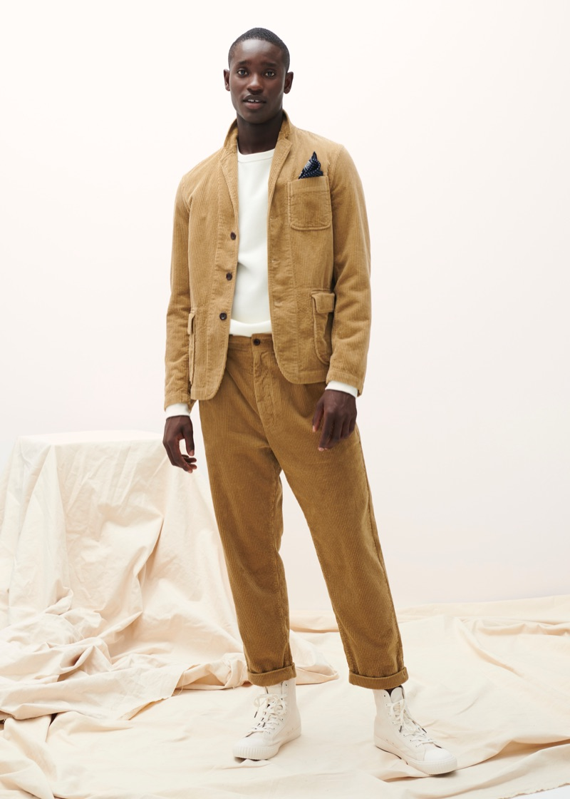 Charles Oduro sports a matching corduroy jacket and pants from Alex Mill's fall 2019 collection.