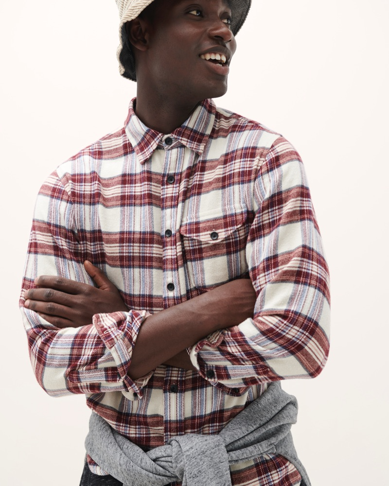 Model Charles Oduro dons a flannel shirt from Alex Mill's fall 2019 collection.